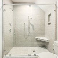 Spacious shower in gleaming white tile