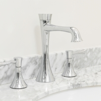 Modern taps and marble countertops and backsplash