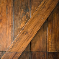 Stained garage doors enhance the transformation