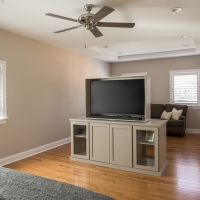 Custom television cabinet in master suite