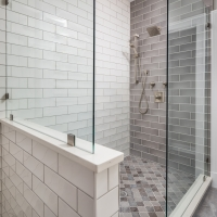 Grey and white tiles for the generous walk-in shower